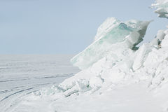 Ice background of huge blocks of aqua ice from fractured floes. Winter backdrop Stock Images