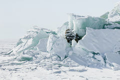 Ice background of huge blocks of aqua ice from fractured floes. Winter backdrop Stock Photo