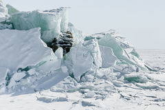 Ice background of huge blocks of aqua ice from fractured floes. Winter backdrop Royalty Free Stock Images