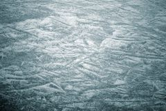 ice background with marks from skating and hockey, blue texture stock image