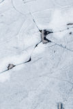 Ice background texture. With a long crack and rock stock image