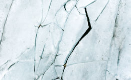 Ice background texture. With a long crack and rock royalty free stock photography