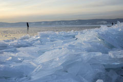 Ice of Baikal lake at sunset. In Russia royalty free stock image