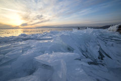 Ice of Baikal lake at sunset. In Russia royalty free stock images