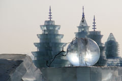 Ice ball in front of ice buildings Stock Photography