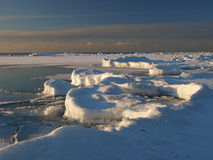 Ice banks on the sea shore Stock Image