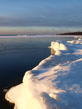 Ice banks on the sea shore Royalty Free Stock Image