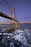 Ice below the Verrazano Narrows Bridge at sunset. Beautiful colors in the sky after the sun set at Verrazano Bridge Stock Photo