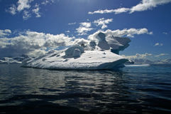 Ice berg antarctica. Ice berg in Antarctic waters with ice boulders perched on top royalty free stock photography