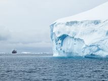 Ice berg and expedition ship. Antarctic Sound Stock Image