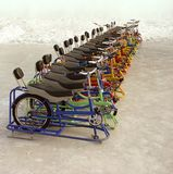 Ice bicycles are fun. A line of colored ice bicycles, you know the kids will want a ride, maybe you do too Stock Photo