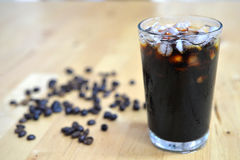 Ice Black Coffee. Thai style Iced Black Coffee on wooden background Stock Photo