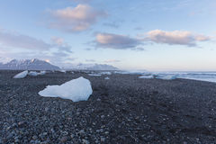 Ice on black rock beach form iceberg skyline in winter season, Iceland Royalty Free Stock Image