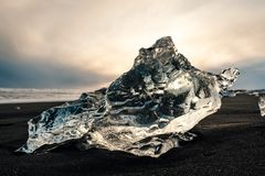 Ice on the black volcanic beach near Jokulsarlon glacier lagoon, Iceland. stock photo