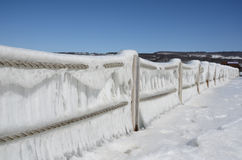 Ice blanketed rope fence facing the harbor on Seneca Lake after w. Showing the Seneca Lake dock after winter storm Stella. One of the Finger Lakes of New York stock image