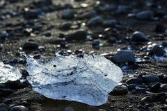 Ice block on black sand beach at glacier lagoon Jokulsarlon, Ice Stock Images