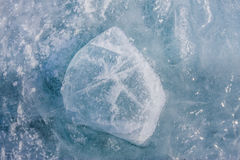 Ice Block covered with cracks texture on the lake Stock Photography