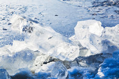 Ice blocks on the edge of ice-hole in frozen lake Stock Photography