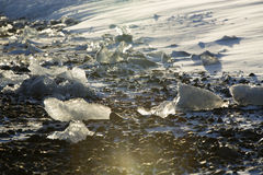 Ice blocks at glacier lagoon Jokulsarlon, Iceland in evening lig Royalty Free Stock Images