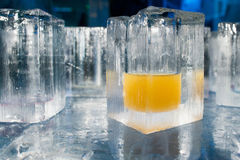 Ice blocks glasses in a ice hotel bar pub Stock Images