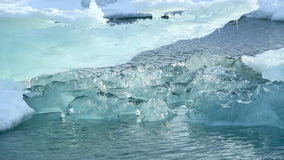 Ice blocks melting at a glacier lagoon in Iceland stock video footage