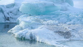 Ice blocks melting at a glacier lagoon in Iceland stock footage