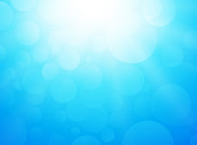 Ice blue background with bokeh and rays Stock Photo