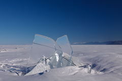 Ice with the blue sky. Transparent block of ice on the frozen Baikal lake with blue sky on the background stock photos