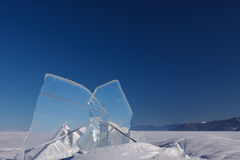 Ice with the blue sky. A transparent floe of ice on the lake Baikal with blue sky on the background Stock Photography