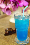 Ice blue soda on timber table Royalty Free Stock Photo