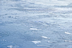 Ice on blue water. Pure blue water with ice and snow background Royalty Free Stock Image