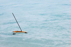 Ice-boat. Parked on surface of frozen lake Royalty Free Stock Photography