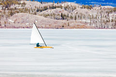 Ice-boat sailing frozen Lake Laberge Yukon Canada Royalty Free Stock Images