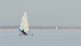 Ice-boat sailing. Sailing on the ice-yacht on the frozen river Royalty Free Stock Photo