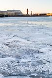 Ice-bound Neva river and Vasilyevsky Island Spit. Ice-bound Neva river and Spit of Vasilyevsky Island with Rostral Column and Old Stock Exchange building in Royalty Free Stock Photos