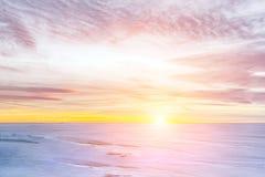 Ice braking on frozen lake, sunset in winter. Royalty Free Stock Image