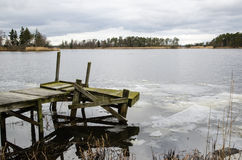 Ice break-up at an old jetty Stock Photo