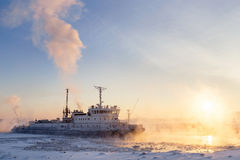 Ice Breaker Breaks Ice at Sunset. Stock Photo