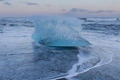 Ice breaking over black sand beach skyline, Iceland Royalty Free Stock Photo