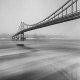 Ice is broken. Footbridge in winter city. Royalty Free Stock Images