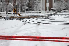 Ice broken power pole. LOUISVILLE - 28 JANUARY: Electric utility pole brought down by weight of ice from storm blocking a road in the Douglass Hills neighborhood royalty free stock images