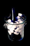 Ice bucket. Crystal ice bucket with blue champagne bottle Royalty Free Stock Photos