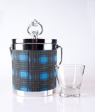 Ice bucket. An ice bucket and a whiskey glass Stock Image