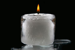 Ice burning candle on a black background Royalty Free Stock Image
