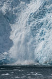 Ice calving into ocean Stock Photo