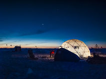 Ice camp at night. Researcher working at an ice camp under clear polar sky Stock Photos