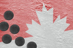 Ice, Canadian symbol and hockey pucks Stock Images