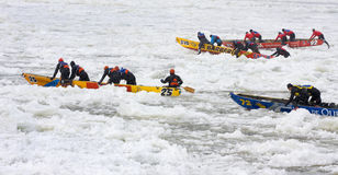 Ice canoes competition during the Carnival of Quebec, Canada Royalty Free Stock Photo
