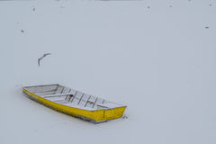 Ice capured yellow boat on frozen Danube river Stock Image