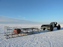 Ice car and sled. On Curonian Spit ice in winter, Lithuania Royalty Free Stock Image
